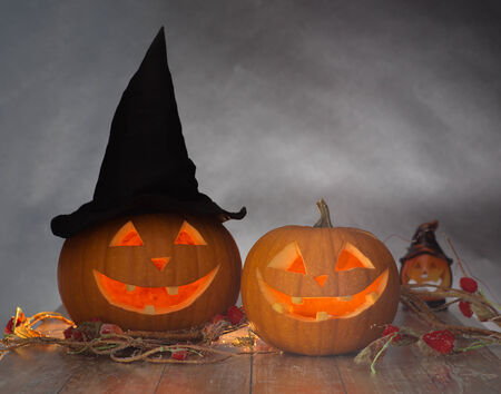 holidays, halloween and decoration concept - close up of pumpkins on table photo