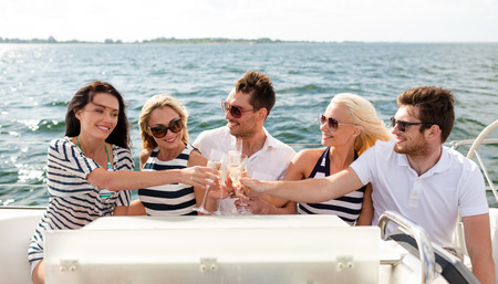 vacation, travel, sea, friendship and people concept - smiling friends with glasses of champagne on yacht Stok Fotoğraf - 32336917