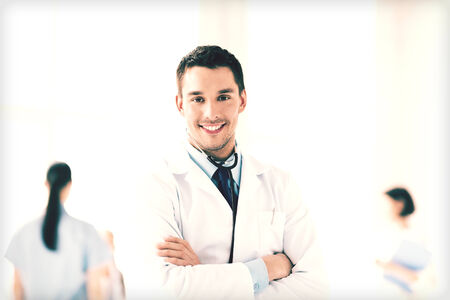 doctors smiling: bright picture of male doctor with stethoscope