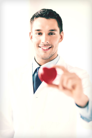 bright picture of male doctor with heart photo