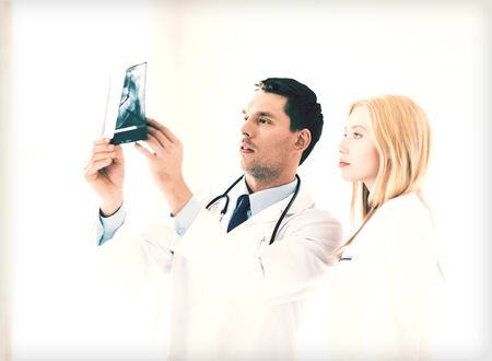 serious doctor: picture of two doctors looking at x-ray