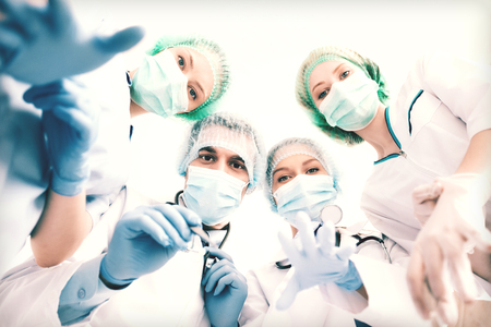 picture of young team or group of doctors in operating room photo