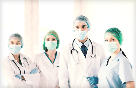 emergency room: picture of young team or group of doctors in operating room Stock Photo