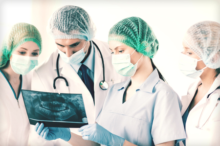 picture of young group of doctors looking at x-ray photo
