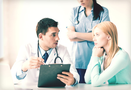 doctor's appointment: bright picture of male doctor with patient Stock Photo