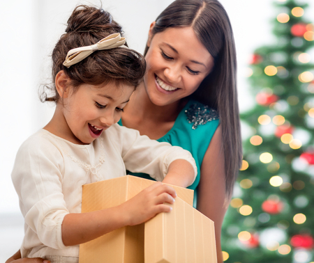 holidays, presents, christmas, xmas concept - happy mother and child girl with gift box photo