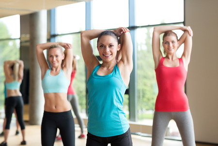fitness, sport, training, gym and lifestyle concept - group of women working out in gym Stock Photo - 32338194
