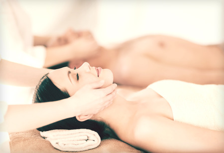 picture of couple in spa salon getting face treatment photo
