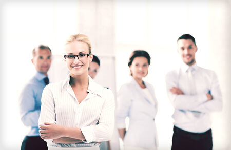 group  accountant: picture of smiling attractive businesswoman in office Stock Photo