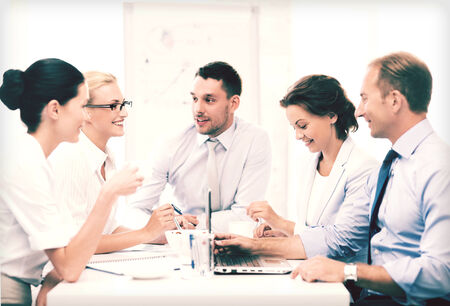 finance director: friendly business team having meeting in office Stock Photo