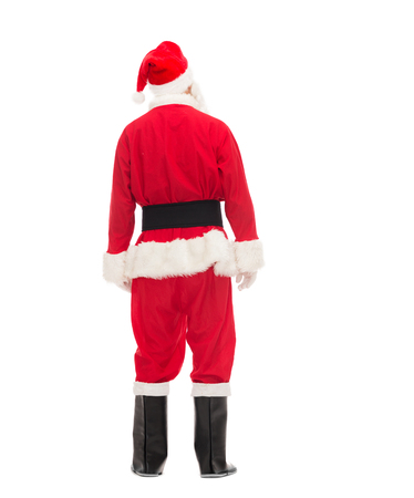 saint nick: christmas, holidays and people concept - man in costume of santa claus from back Stock Photo