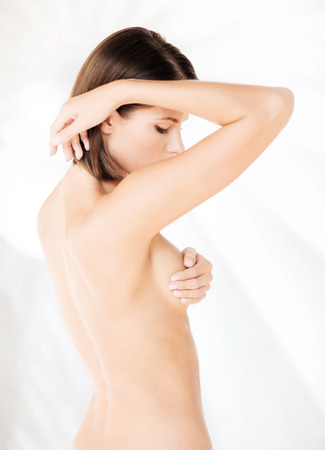 breasts erotic: health, medicine, beauty concept - woman checking breast for signs of cancer Stock Photo