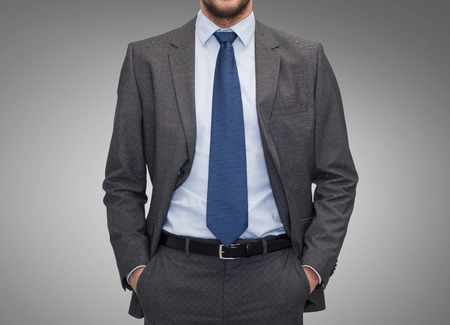 work suit: business, people and office concept - close up of businessman over gray background