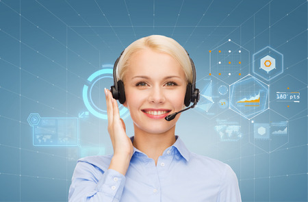 helpline: business, technology and call center concept - friendly female helpline operator with headphones