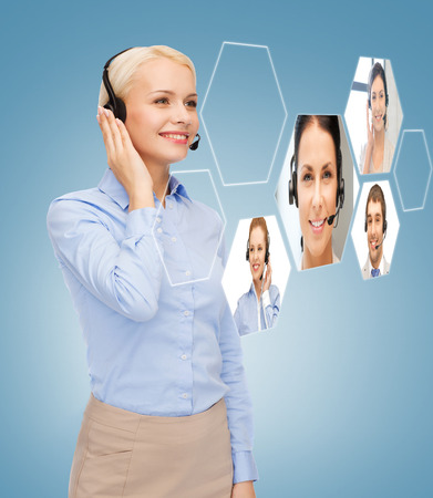business, technology, call center and people concept - smiling woman helpline operator with headphones Stock Photo