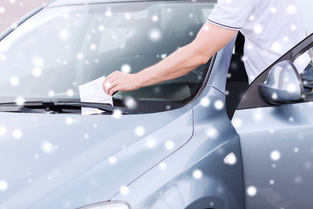 close up of parking ticket on car windscreen photo