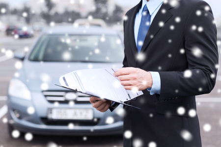 transportation, people, sale and ownership concept - close up of man with clipboard and car documents photo