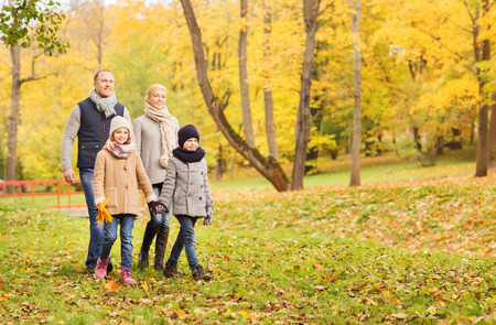 teen love: family, childhood, season and people concept - happy family in autumn park Stock Photo