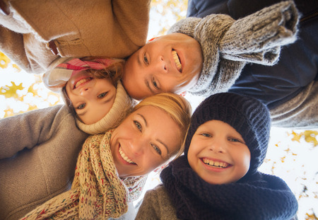 family, childhood, season and people concept - happy family in autumn park Stock Photo