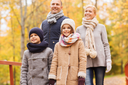 preteen boys: family, childhood, season and people concept - happy family in autumn park Stock Photo