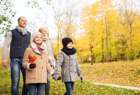 young boys: family, childhood, season and people concept - happy family in autumn park Stock Photo