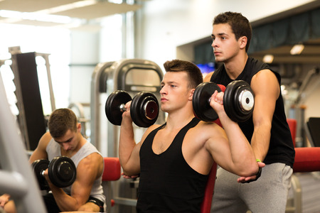 dumbbell: sport, fitness, lifestyle and people concept - group of men with dumbbells in gym Stock Photo