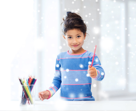 asian preteen: creativity, childhood and people concept - smiling little girl with pencils drawing at home