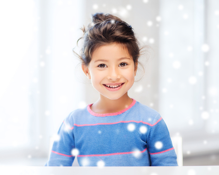 asian preteen: childhood and people concept - smiling little girl indoors