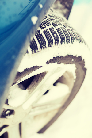 radial tire: transportation, winter and vehicle concept - closeup of car winter tire Stock Photo