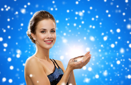 large woman: people, holidays, christmas and glamour concept - smiling woman in evening dress with diamond over snowy city background