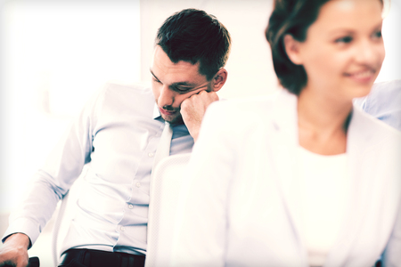 bad planning: business concept - tired businessmen sleeping on conference or meeting Stock Photo