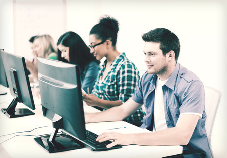 distance education: education concept - student with computer studying at school