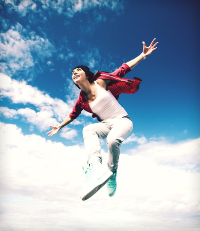 urban dance: sport, dancing and urban culture concept - beautiful dancing girl jumping