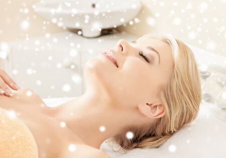 closed eye: beauty, health, people and spa concept - beautiful young woman in spa