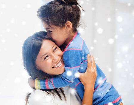 latin mother: childhood, happiness, family and people concept - smiling little girl and mother hugging indoors