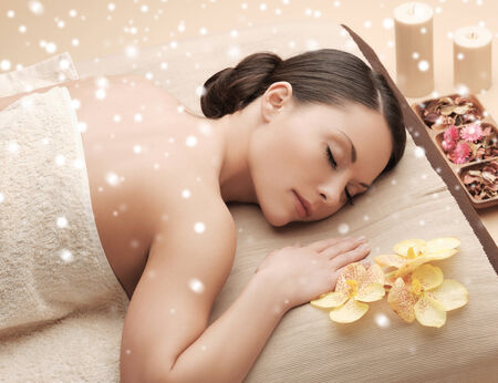 relax massage: beauty, health, people and spa concept - beautiful young woman in spa