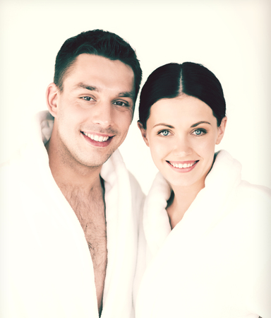 picture of couple in spa salon in white bathrobes photo