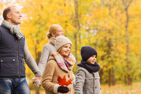 boys and girls: family, childhood, season and people concept - happy family in autumn park Stock Photo