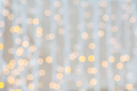 holidays, party and celebration concept - blurred glden lights background photo