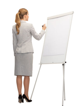business, education and office concept - businesswoman or teacher with marker writing or drawing something imaginary on whiteboard from back