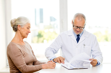 medicine, age, health care and people concept - senior woman\ and doctor meeting in medical office