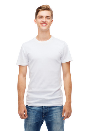 white shirt: t-shirt design and people concept - smiling young man in blank white t-shirt