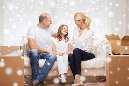 accommodation: family, people, accommodation and happiness concept - smiling parents and little girl moving into new home over snowflakes background