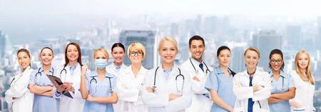 family doctor: medicine and healthcare concept - team or group of doctors and nurses