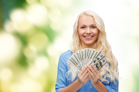 finances and people concept - smiling woman in red dress with us dollar money