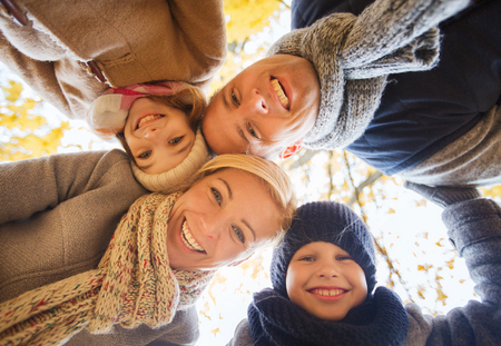 preteen: family, childhood, season and people concept - happy family in autumn park Stock Photo