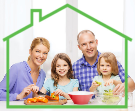 food, family, children, happiness and people concept - happy family with two kids making dinner at home behind green house symbol photo