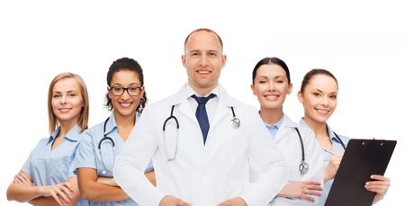 doctor appointment: medicine, profession, teamwork and healthcare concept - international group of smiling medics or doctors with clipboard and stethoscopes over white background