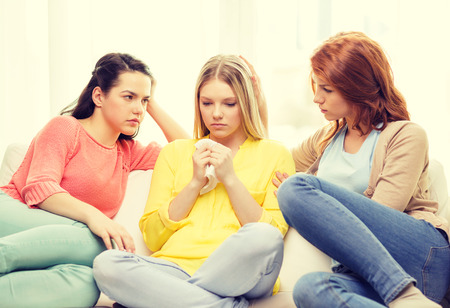 girl sit: friendship and people concept - two teenage girls comforting another after break up