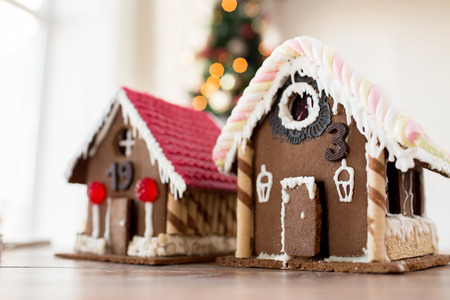 sugarcoated: holidays, christmas, baking and sweets concept - closeup of beautiful gingerbread houses at home Stock Photo